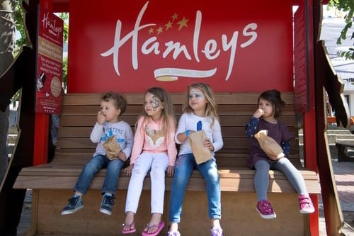 Children on bench waiting for a Wattman train